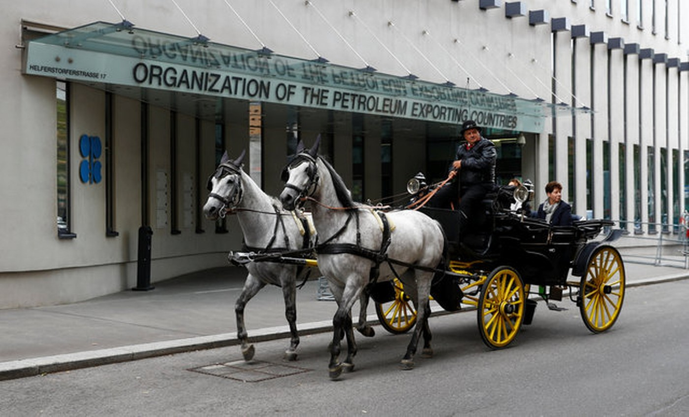 A fiaker horse carriage passes the Organization of the Petroleum Exporting Countries (OPEC) headquarters in Vienna