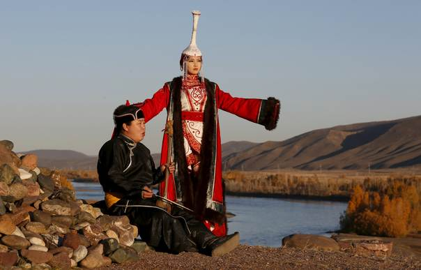 People perform at the Aldyn Bulak area on the bank of the