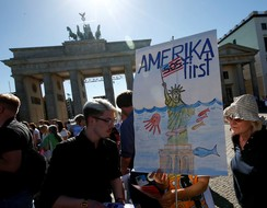 People protest beside Berlin's U.S. embassy against the U.S. withdrawal from the Paris climate deal
