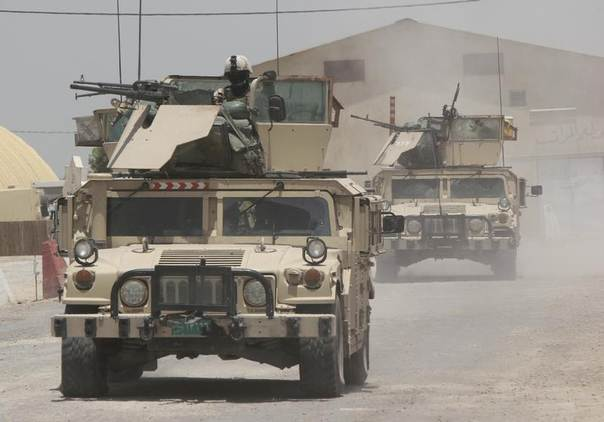 Iraqi security forces ride on vehicles during an intensive security deployment in the town of Jurf al-Sakhar, south of Baghdad, June 30, 2014. REUTERS/Alaa Al-Marjani