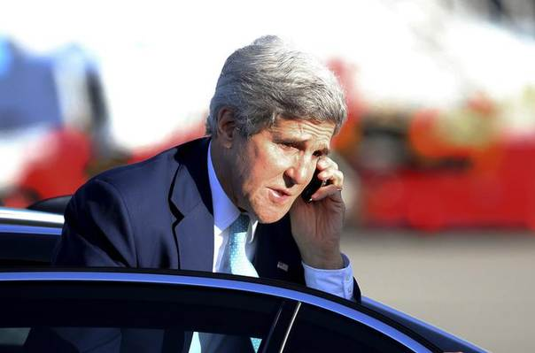 U.S. Secretary of State John Kerry talks on a mobile phone as he arrives at Sydney airport, August 13, 2014. REUTERS/Rob Griffith/Pool
