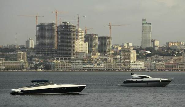 In this 2010 file photo, speedboats sit beneath the backdrop of Luanda REUTERS/Rafael Marchante