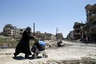 On election eve, ruined Homs shows cost of Syria's war