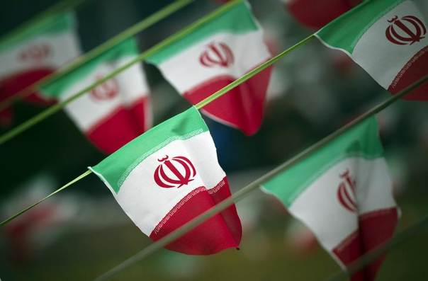 In this 2012 file photo, Iran's national flags are seen on a square in Tehran REUTERS/Morteza Nikoubazl