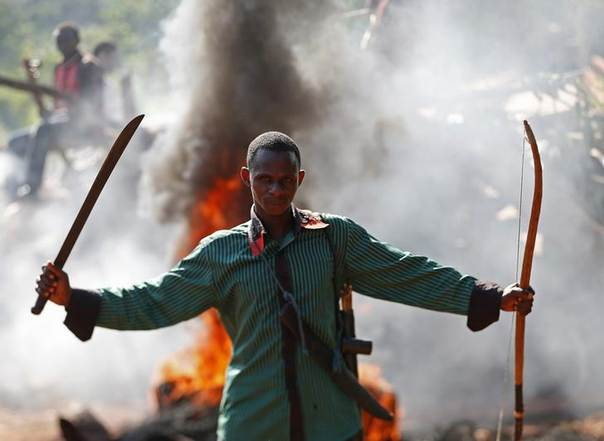 A man gestures in front of a burning barricade during a protest against French soldiers in Bambari May 22, 2014.