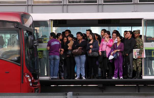 Passengers of the Bogota rapid bus network, known locally as TransMilenio, wait in a station for their route in a central avenue in Bogota, Colombia, on September 29, 2011. REUTERS/Felipe Caicedo