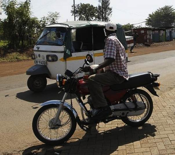A motorbike taxi waits for a passenger in Kenya's western town of Kisumu, 350 km (218 miles) from the capital Nairobi, March 9, 2013. REUTERS/Thomas Mukoya