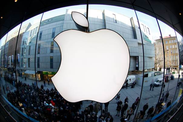 People wait on a street in front of an Apple store as they await sales of the new iPad in Munich on March 16, 2012. REUTERS/Michaela Rehle