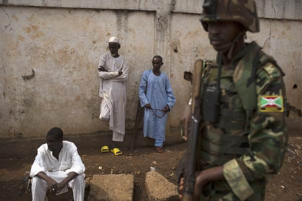 An African Union (AU) soldier stands guard outside a home at the end of a funeral of two men killed by sectarian violence in the Muslim neighbourhood of Kilometre 5 (PK5) in the capital Bangui March 23, 2014. REUTERS/Siegfried Modola