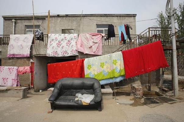 Laundry hangs on clotheslines outside a house in a migrant workers' village in the outskirts of Beijing April 26, 2013.  REUTERS/Kim Kyung-Hoon