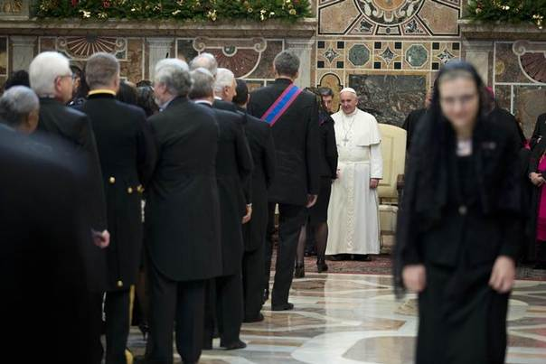 Pope Francis is greeted by ambassadors during an audience with the diplomatic corps at the Vatican, January 13, 2014. REUTERS/Andrew Medichini/Pool