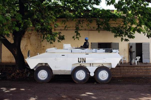 A UN peacekeeper from Senegal sits in an armored vehicle during patrol in Bamako, Mali, August 22, 2013. REUTERS/Joe Penney