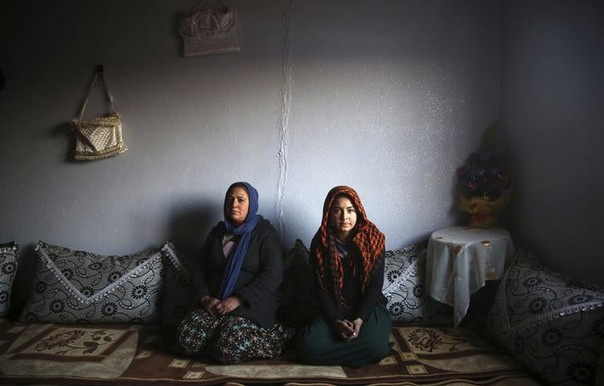Tahsiye Ozyilmaz, 33, and her daughter Halime, 14, pose for a photograph at their home in Zeytinpinar Village of Derik, a Kurdish town in Mardin Province in Turkey February 1, 2014.   Tahsiye, who is a housewife, didn't go to school. She says would have liked to become a teacher, but she had an arranged marriage at the age of 17. Now she would like her daughter to finish her education and become a doctor.   Halime stopped going to school last year because it was 10 km (6 miles) from her house and the journey was too difficult. She says she would have liked to become a doctor, but now this is impossible.  Halime says she thinks she will have an arranged marriage when she is 17 or 18, like her mother did.