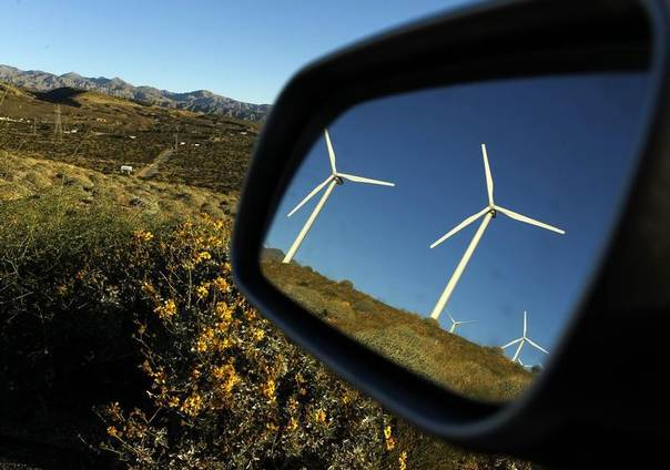 Windmills are reflected in a car mirror at a wind farm in Palm Springs, California, Feb. 9, 2011. REUTERS/Lucy Nicholson
