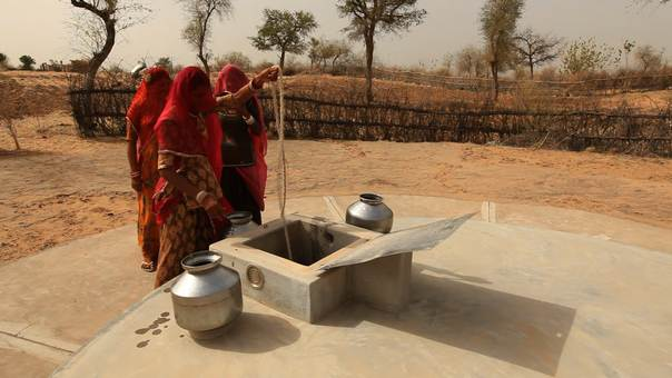 Women draw water from Tanka well in Barmer district, Rajasthan. Photo Credit: TERI