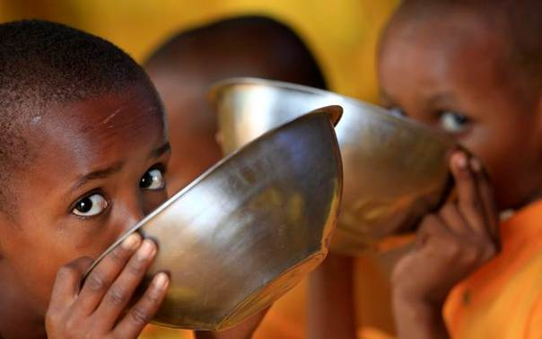 In a file photo from 2011, Somali refugee boys eat porridge during break time at the Liban integrated academy at the Ifo refugee camp in Dadaab, near the Kenya-Somalia border. REUTERS/Thomas Mukoya