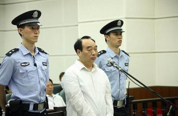 Lei Zhengfu, a former regional Communist Party official, attends his trial at a court in Chongqing municipality June 19, 2013. Lei, who is implicated in a sex scandal that has transfixed China, was sentenced on June 28, 2013 to 13 years in jail for bribery, government news agency Xinhua reported on Friday REUTERS/Stringer