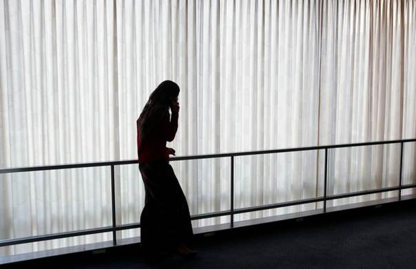 A woman pauses to speak on the phone in a hallway at the United Nations headquarters in New York, on Sept. 24, 2008. REUTERS/Mike Segar