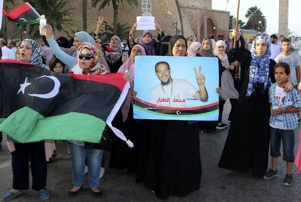 People take part in a demonstration in support of ex-rebel fighters and against