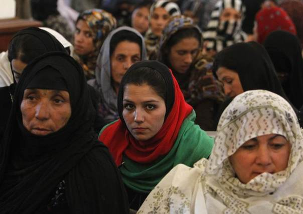 Women listen to a speech by Afghanistan's President Hamid Karzai during a district assembly gathering, in Kabul, Afghanistan, May 30, 2013. REUTERS/Omar Sobhani