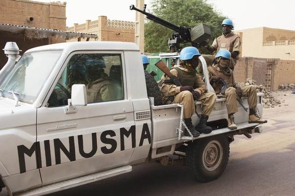 UN peacekeepers from Burkina Faso patrol on election day in Timbuktu July 28, 2013. REUTERS/Joe Penney