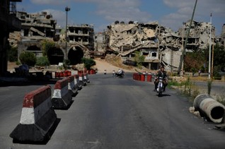 Syrian city's rebel districts still in ruins years after Assad victory