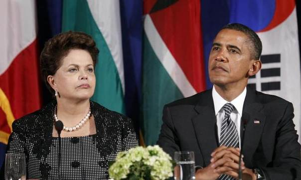 In this 2011 file photo, U.S. President Barack Obama and Brazil's President Dilma Rousseff watch a video introduction to the Open Government Partnership event in New York REUTERS/Kevin Lamarque