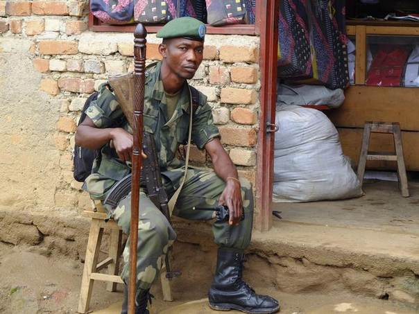 A soldier keeps watch in Nyabibwe, a mining town in the Kivus, one of the most conflict-torn regions of the Democratic Republic of Congo and the source of many of the minerals that have financed violence here since the 1990s. A tagging project is underway here to authenticate that the minerals are