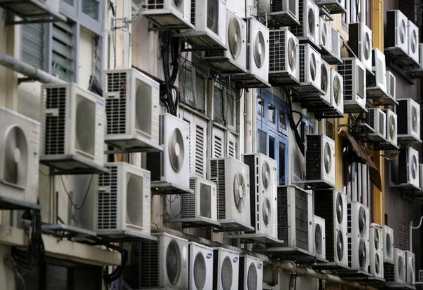 Rows of air conditioners on the walls of a building in Singapore's financial district, Dec. 11, 2009. REUTERS/Vivek Prakash