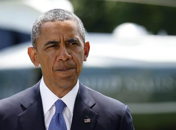 U.S. President Barack Obama pauses whle delivering a statement on the situation in Iraq, prior to departing the White House South Lawn in Washington, June 13, 2014. REUTERS/Kevin Lamarque