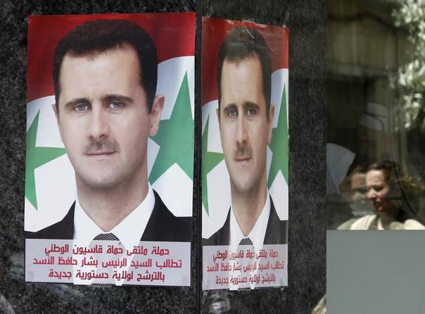 Posters of Syrian President Bashar al-Assad placed by pro-Assad group