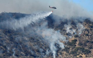 Crews wary as gusty winds stoke huge California wildfire