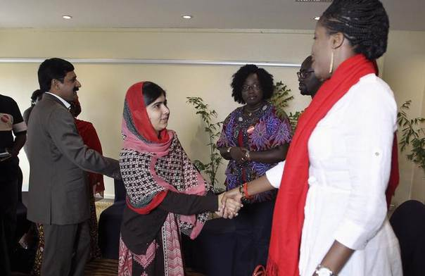 Pakistani schoolgirl activist Malala Yousafzai (2nd L) shakes hands as she is welcomed during a meeting with the leaders of the ${esc.hash}BringBackOurGirls Abuja campaign group, in Abuja July 13, 2014. REUTERS/Afolabi Sotunde