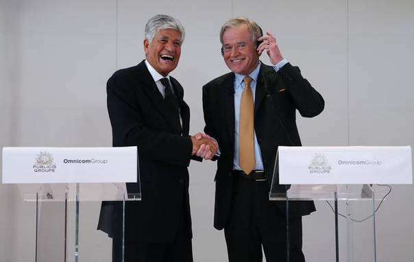Maurice Levy (L) , French advertising group Publicis Chief executive, and John Wren, head of Omnicom Group react during a joint news conference in Paris, July 28, 2013 REUTERS/Christian Hartmann