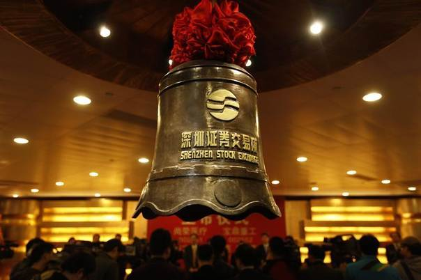 A bell bearing the logo of the Shenzhen Stock Exchange is seen during a companies listing ceremony in Shenzhen, Guangdong province in February 2011. REUTERS/Stringer