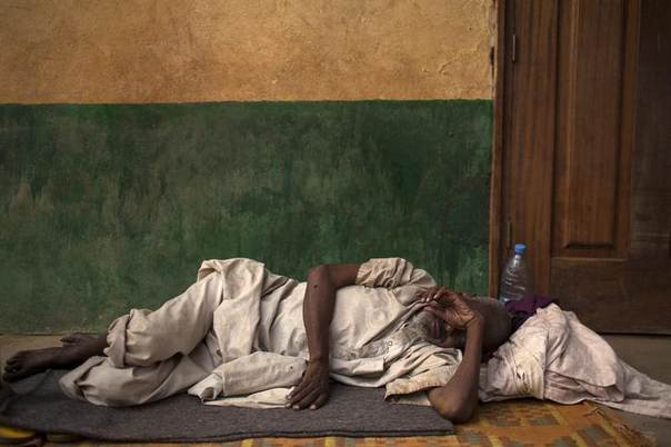 A man sleeps next to a mosque near Kilometre 12 (PK12) where internally displaced muslims are stranded due to the ongoing sectarian violence in the capital Bangui March 19, 2014. REUTERS/Siegfried Modola
