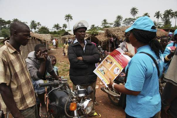 A UNICEF worker speaks with drivers of motorcycle taxis about the symptoms of Ebola virus disease (EVD) and best practices to help prevent its spread, in the city of Voinjama, in Lofa County, Liberia in this April 2014 UNICEF handout photo.