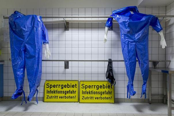 Protective suits hang in the quarantine station for patients with infectious diseases at the Charite hospital in Berlin August 11, 2014.  REUTERS/Thomas Peter
