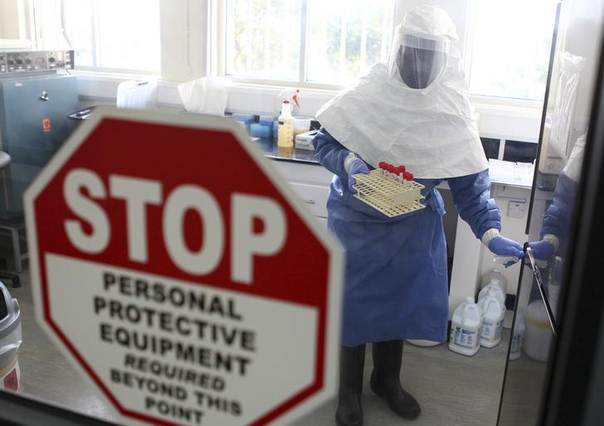 A doctor works in a laboratory on collected samples of the Ebola virus at the Centre for Disease Control in Entebbe, about 37 km (23 miles) southwest of Uganda's capital Kampala, August 2, 2012. REUTERS/Edward Echwalu