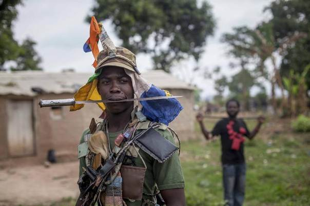 Anti-balaka fighters from the town of Bossembele patrol in the Boeing district of Bangui, Central African Republic, February 24, 2014. REUTERS/Camille Lepage