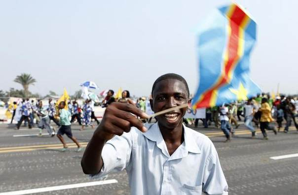 In this 2010 file photo, a man waves a Congolese flag during a civil and military parade marking the 50th anniversary of the independence of the Democratic Republic of Congo in Kinshasa REUTERS/Sebastien Pirlet