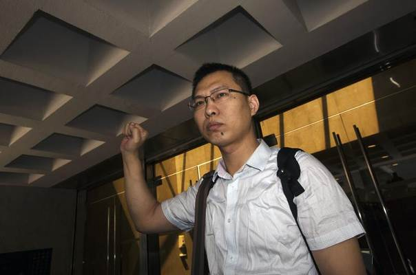 Li Jianjun, former investigative reporter from the coal-rich province of Shanxi, leaves the High Court of Hong Kong, August 5, 2013. REUTERS/Tyrone Siu