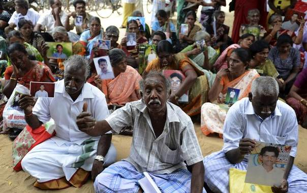 Sri Lankan Tamils hold pictures of family members who disappeared during the war against the Liberation Tigers of Tamil Eelam (LTTE) during a protest in Jaffna, about 400 km (250 miles) north of Colombo November 15, 2013. REUTERS/Stringer