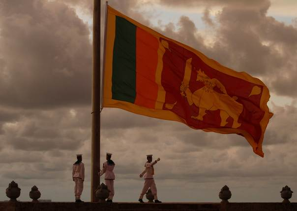 In a 2011 file photo, members of the military lower the Sri Lankan national flag in the evening at Galle Face Green in Colombo. REUTERS/Dinuka Liyanawatte