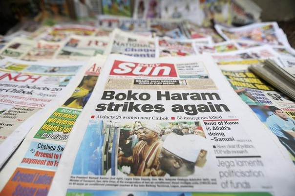 A newspaper with its frontpage headline on an abduction of women from a village in northeast Nigeria, is displayed at a vendor's stand along a road in Ikoyi district in Lagos June 10, 2014.REUTERS/Akintunde Akinleye