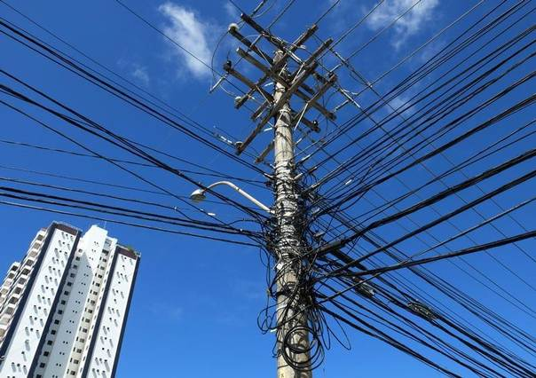 Cables are seen around a utility pole in Salvador, Brazil, July 1, 2014. REUTERS/Yves Herman