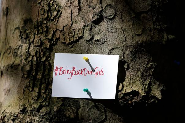 A sign pinned to a tree during a demonstration against the kidnapping of schoolgirls outside the Nigerian Embassy in London May 9, 2014. REUTERS/ Olivia Harris