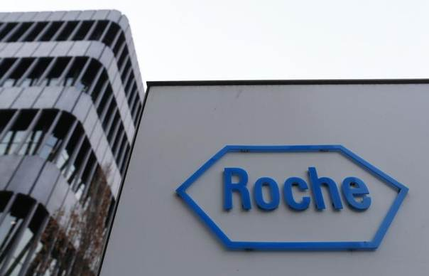 The logo of Swiss pharmaceutical company Roche is seen outside their headquarters in Basel January 30, 2014 REUTERS/Ruben Sprich
