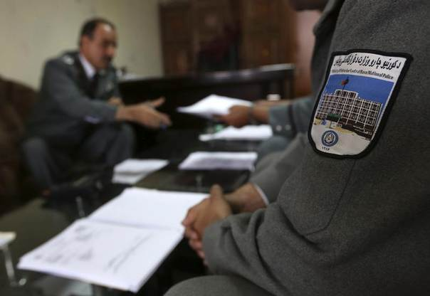 Police officers from anti-corruption Shafafiyat unit work on documents at their office in Kabul, Afghanistan, April 23, 2013. REUTERS/Omar Sobhani