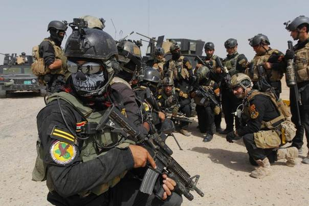 Members of the Iraqi Special Operations Forces (ISOF) prepare before going out on a patrol in the town of Jurf al-Sakhar, south of Baghdad, June 30, 2014. REUTERS/Alaa Al-Marjani
